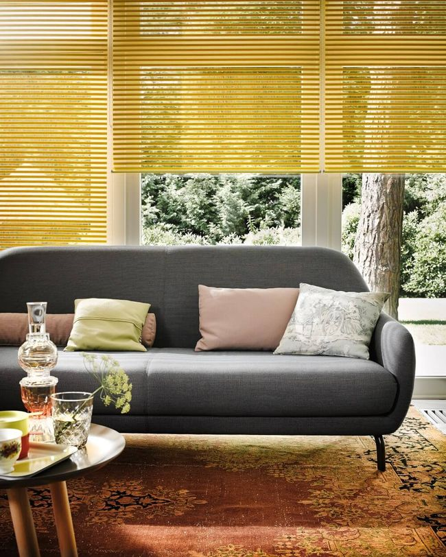 yellow coloured blinds for windows with a stunning sofa and colourful pillows