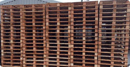Lots of new pallets piled on top of each other at BWP