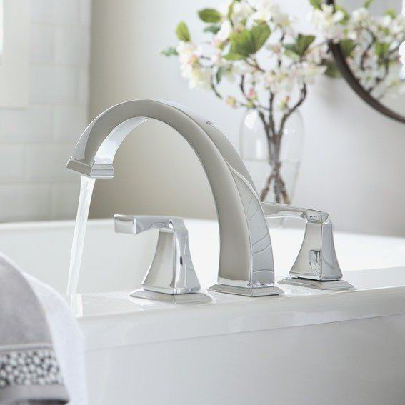 bathroom sink tap with flowing water