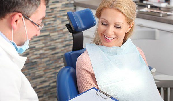 Woman consulting with dentist