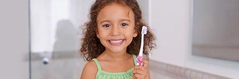 pediatric dentistry - young kid with toothbrush