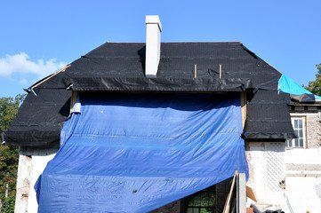 How To Tarp A Roof For Temporary Repair