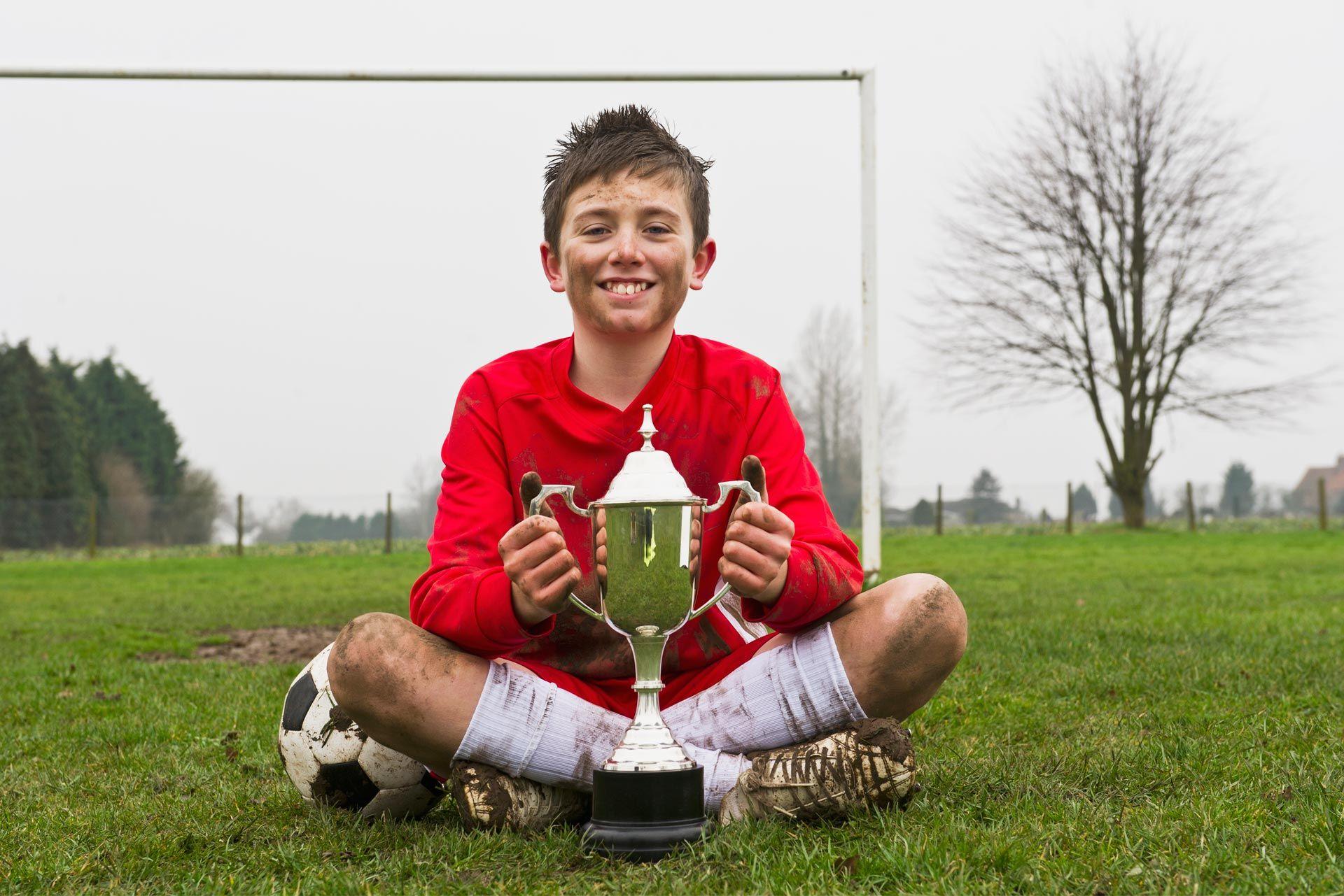 a boy with a trophy